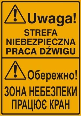 Uwaga! Strefa niebezpieczna praca dźwigu (tablica w języku polskim i ukraińskim)